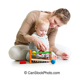 mother and baby play with wooden toy