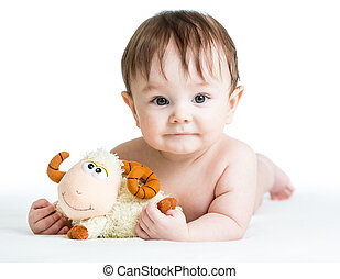 baby boy lying on tummy with lamb toy