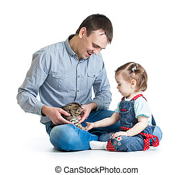 kid girl and her father play with cat kitten