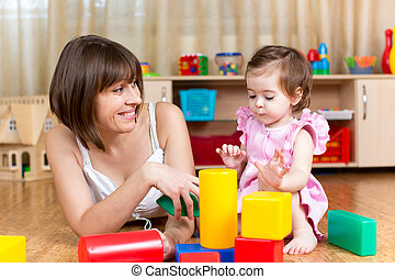 mom and kid play toys indoors
