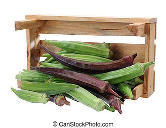 green and red okra falling out of crate