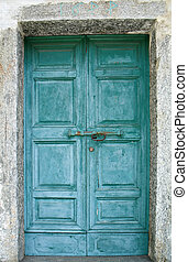 old green door - An old green door of a church in a mountain...