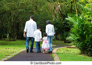 Happy Indian family walking outdoor - Indian family at...