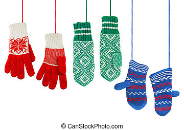 Mittens - Three pairs of woolen knitted mittens on a white...