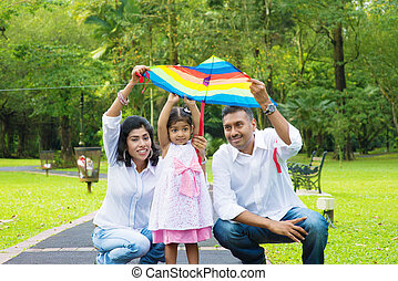 Parents flying kite with child
