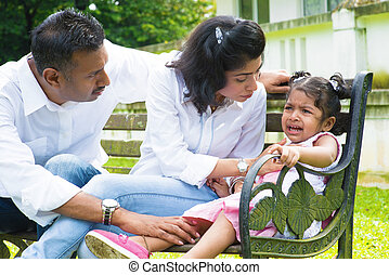 Parents is comforting their crying daughter - Indian family...