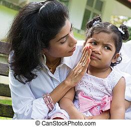 Upset Indian girl - Indian family outdoor. Parent is...