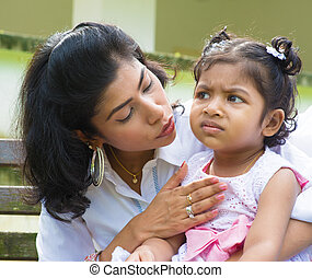 Mother comforting upset Indian girl - Indian family outdoor....