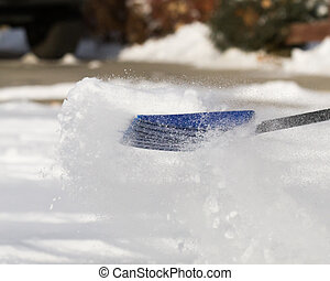 snow day outside - Shovel in mid push trying to clear the...