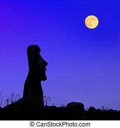 Easter island at full moon - A silhouette of a stone statues...