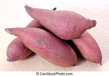 sweet potato - some red sweet potato on the table
