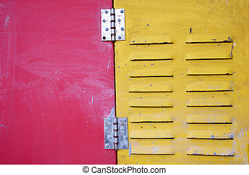 red and yellow iron door with air hole