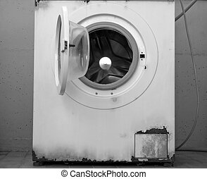 time to change your washing machine: an old rusty washing...