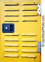 yellow iron door with air hole
