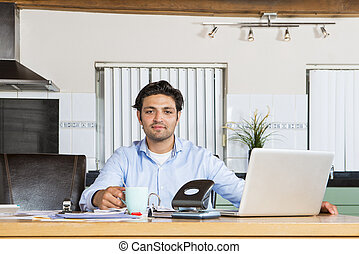 Confident man working on his administration - Young man sits...