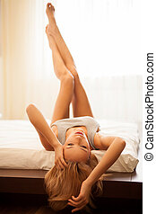 Relaxing at the day time Beautiful young blond hair woman in...