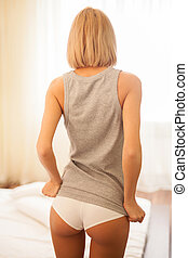 Beauty with firm buttocks Rear view of beautiful young blond...