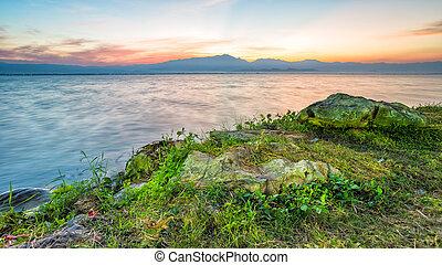sunset behind mountain in lagoon - twilight time sunset...
