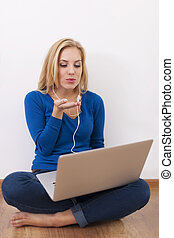 Beautiful woman blowing kisses during the conversation by internet