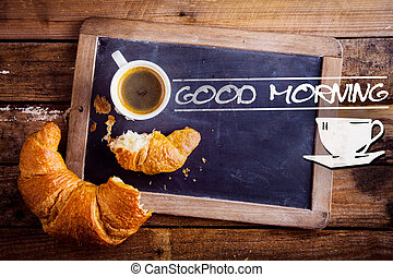 Good morning with coffee and a croissant - Good morning sign...