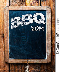 Old grunge BBQ advertising sign on an old school slate board...