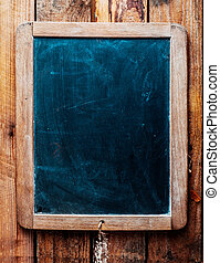 Vintage chalkboard over wood background. - Vintage style...