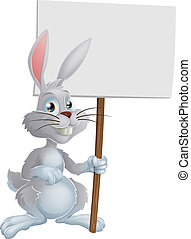 White Easter bunny holding sign - A cute cartoon white...