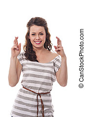 Smiling woman with fingers crossed