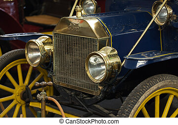The grill and headlamps of an expensive vintage  classic car.