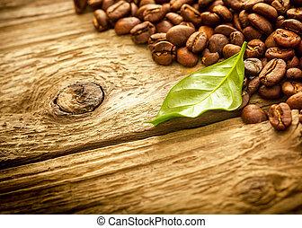 Fresh medium roast coffee beans on rustic wood - Pile of...