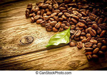 Background of coffee beans on rustic driftwood - Background...