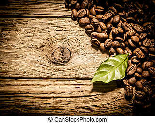 Fresh roast coffee beans on weathered driftwood