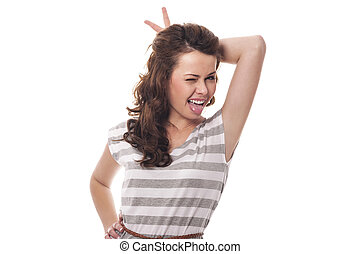 Funny woman with horns sticking out tongue