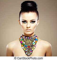 Portrait of young beautiful woman with jewelry Beauty photo