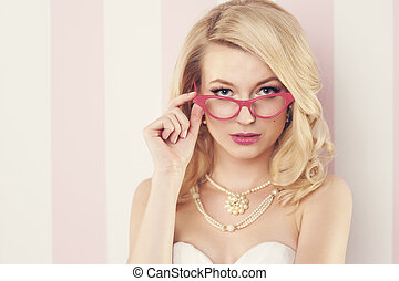 Sexy elegant woman wearing cats eye glasses