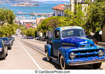 San Francisco Hyde Street and vintage car with Alcatraz...