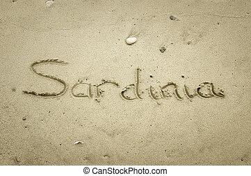 Sardinia - written in sand on beach texture - Travel...