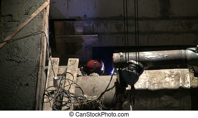 Welder works on Construction of concrete buildings at night