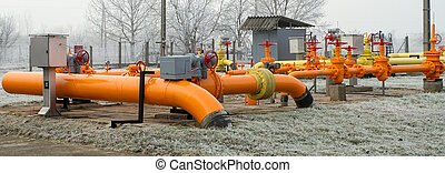orange gas pipe in frosted winter