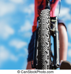 Mountain Bike and blue sky background. Focus on the front...