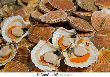 Opened scallops at market stall
