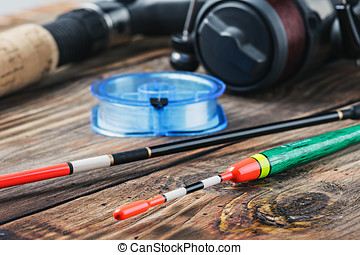 fishing tackle on a wooden table. Focus on the front of the...