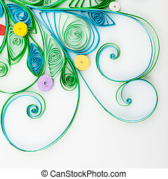 Quilling. Made of strips of paper snowflake on a white...