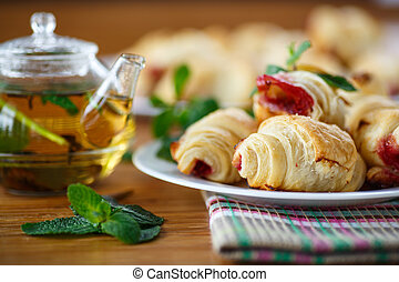 croissants with jam on a wooden table