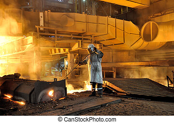 steel worker - worker with hot steel in plant