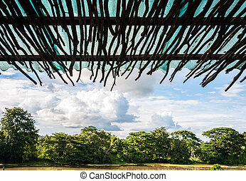 Wooden eaves - Tropical view from wooden eaves of small...