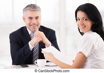 Woman on job interview. Cheerful young woman looking over...