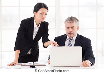 Project discussion Confident mature businessman sitting at...