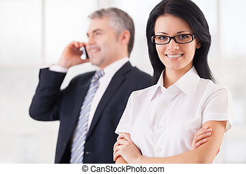 Confident and successful business people Smiling young woman...