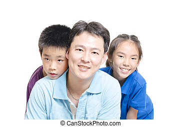 Children with father smiling to the camera